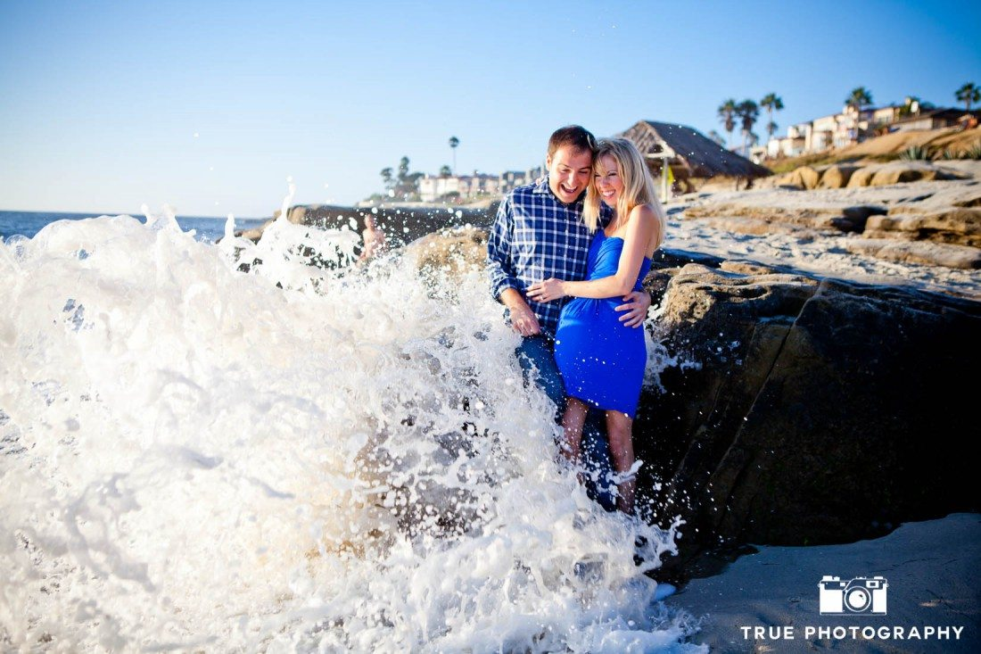 Windansea engagement photo shoot of wave crashing