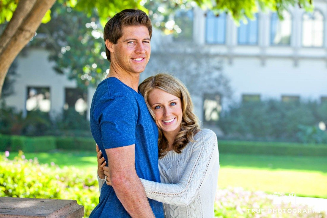 Engagement shoot photo of USD Campus causal couple hugging