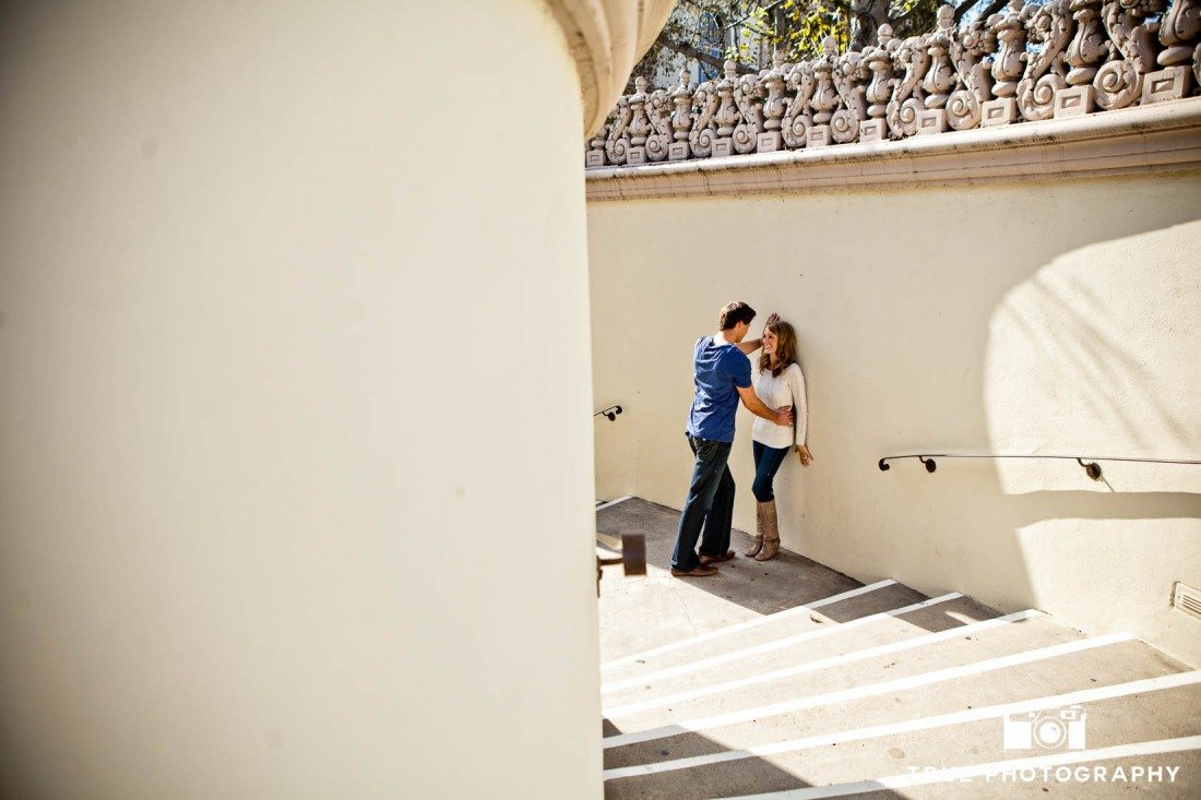 Engagement photo shoot of USD Campus couple on large staircase