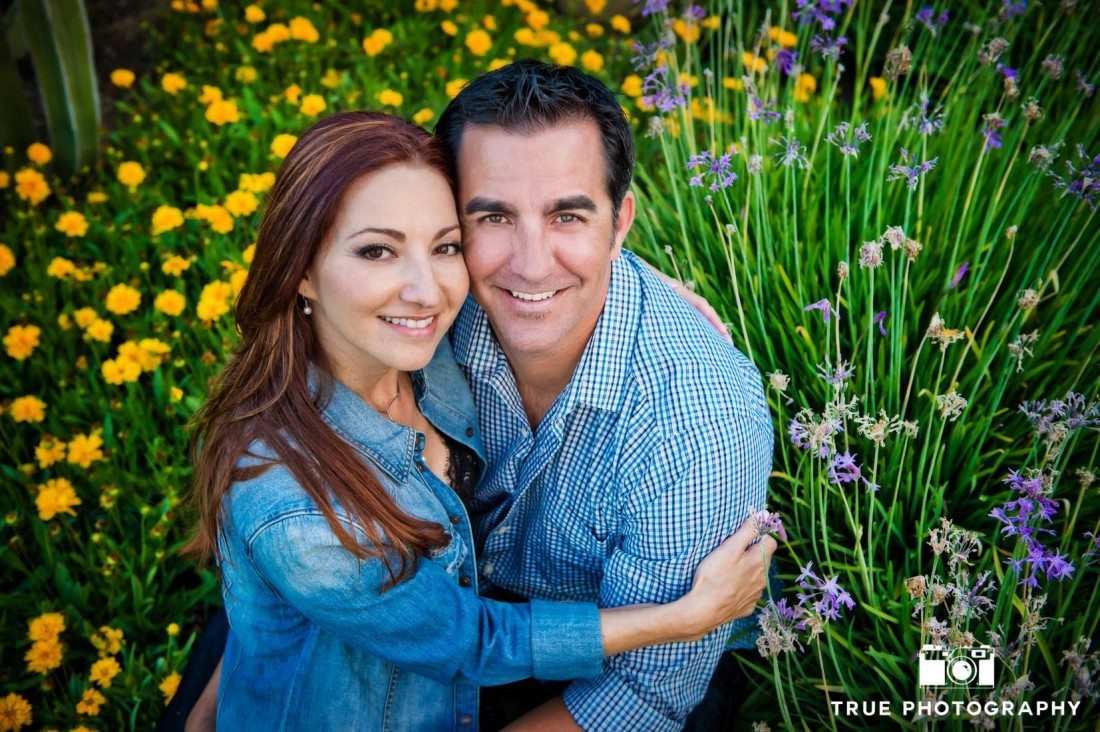 couple in natural field setting at Seaport Village Engagement Photo Shoot