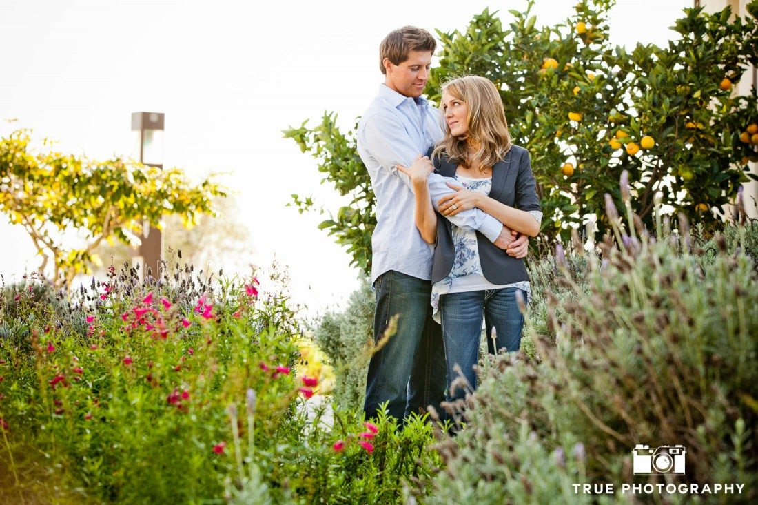 Engagement Photo Shoot of Couple standing in garden