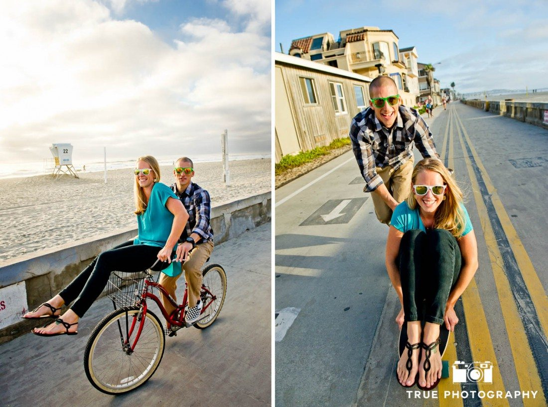 engagement photo shoot of Pacific Beach couple riding bikes and skateboard on boardwalk