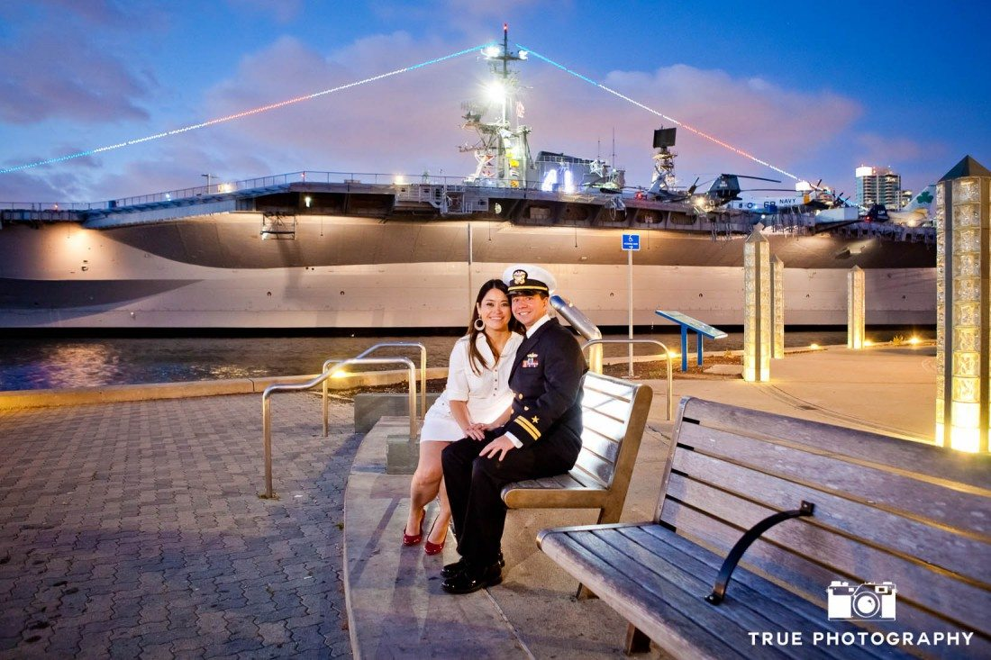 Seaport Village Engagement Photo Shoot couple on bench with harbor