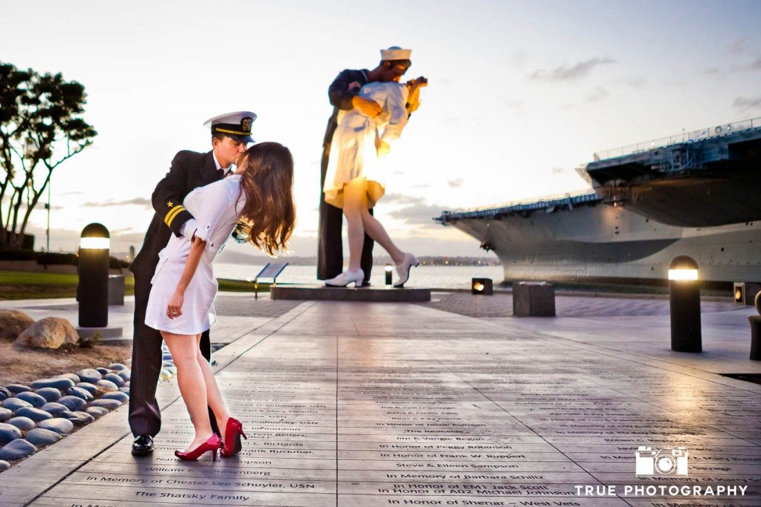 engaged couple reenacting statue at Seaport Village Engagement Photo Shoot