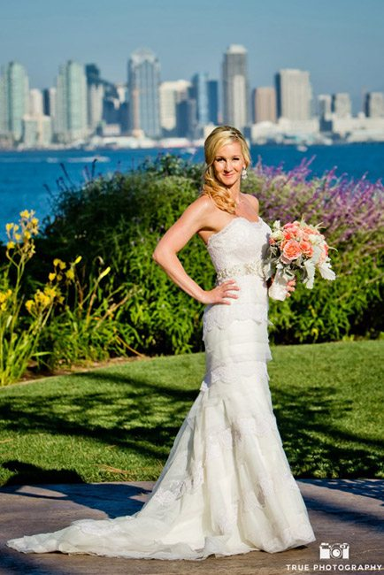 Guess the wedding dress designer of this White Flower Bridal Boutique gown