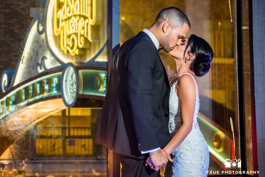 couple kissing by Gaslamp Quarter sign