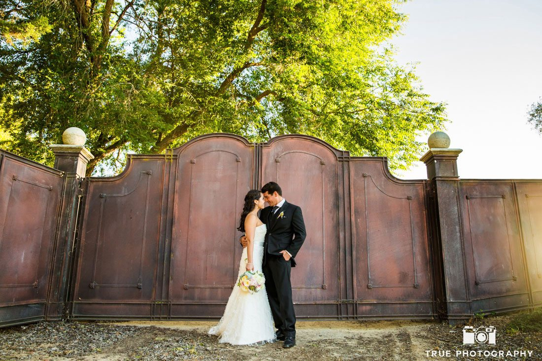 Bride and Groom at the gates of Calipaso winery in Pasa Robles, California