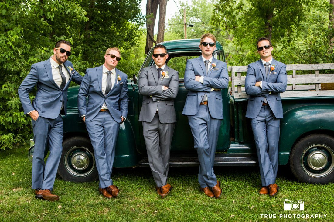 groomsmen wearing sunglasses against truck