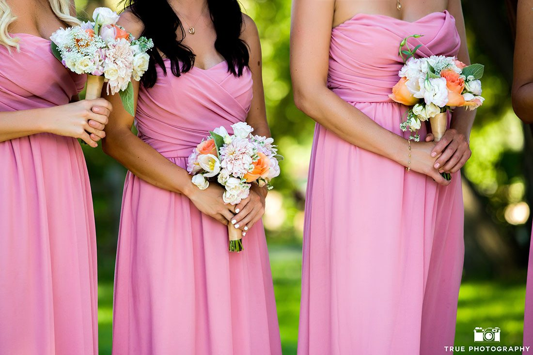 pink bridesmaids dresses and bouquets