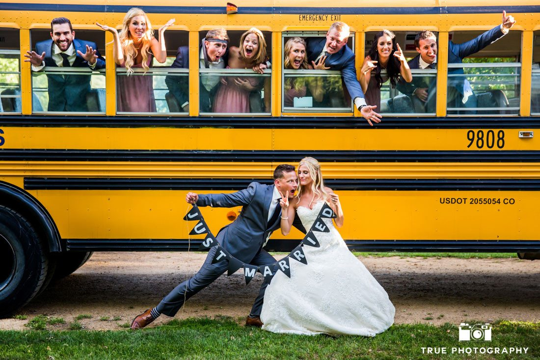 bridal party leaning out of school bus