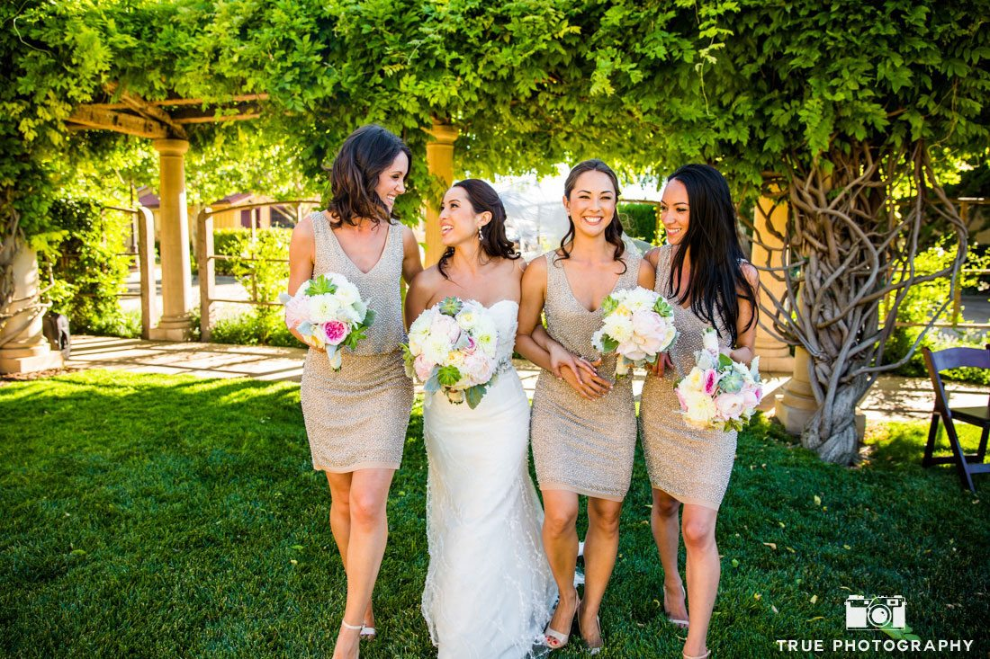 Bridesmaids having fun before the winery wedding