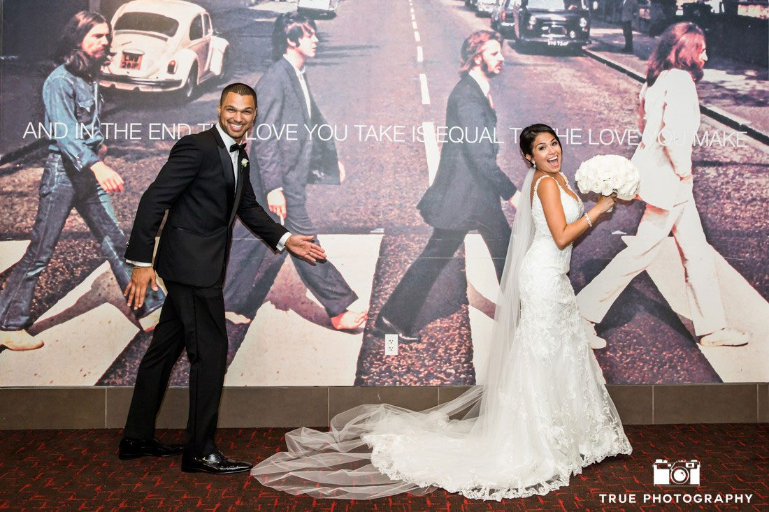 bride and groom in front of abbey road beatles photo