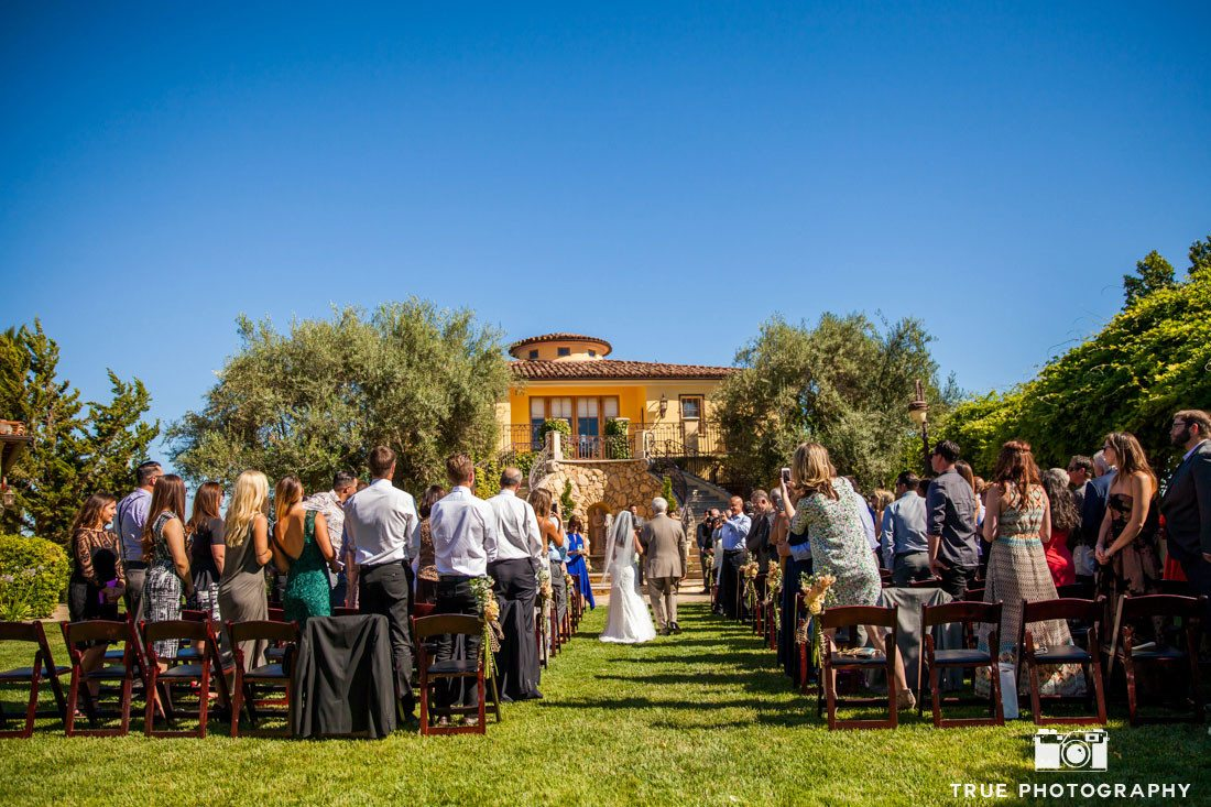 Bride and father walking down the aisle at calipaso winery