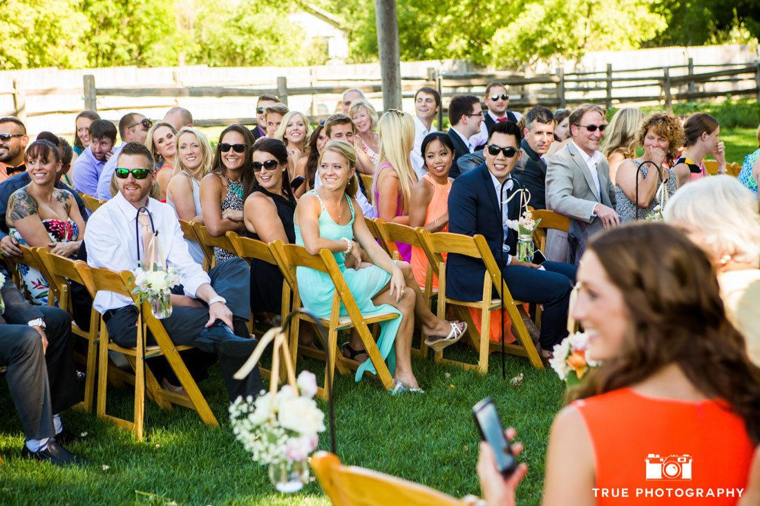 wedding guests turning around during ceremony