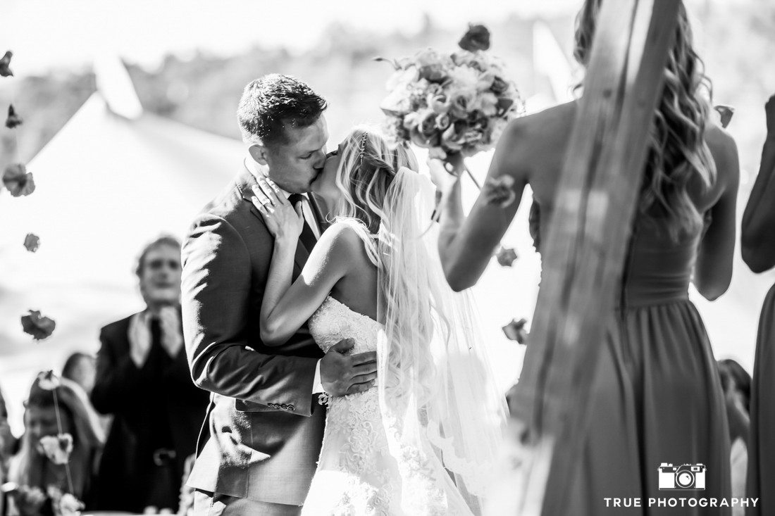 bride and groom kiss in b&w