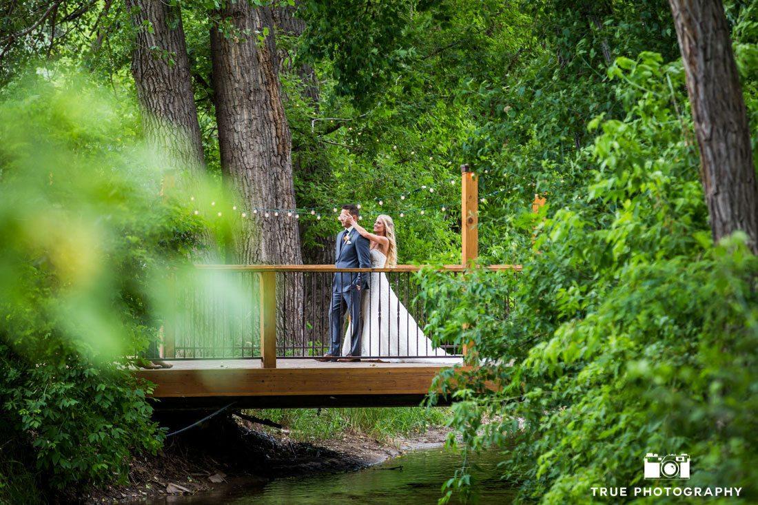 bride and groom first look on bridge