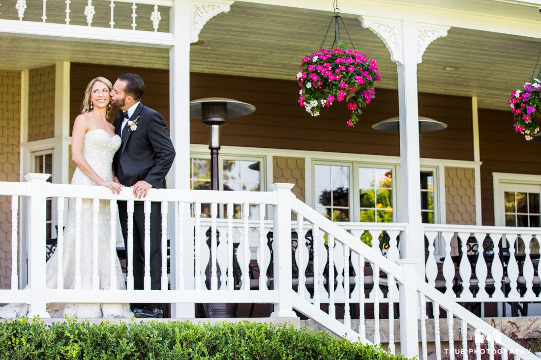 Bride and Groom pose outside Beverly Mansion