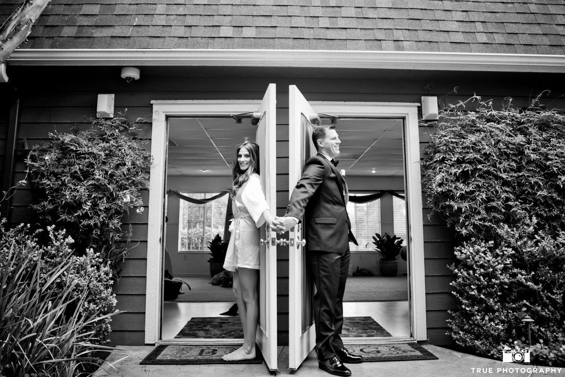 Bride and Groom's First Look between doorway