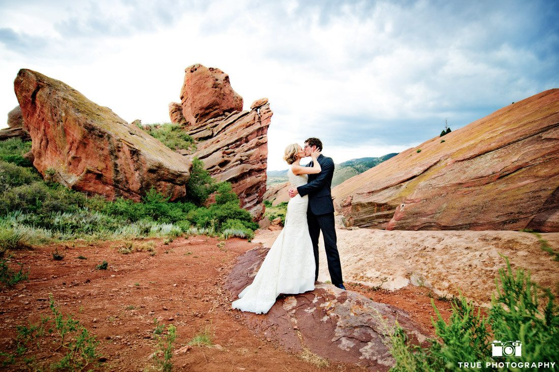Bride and Groom lean in for kiss on mountain in Colorado