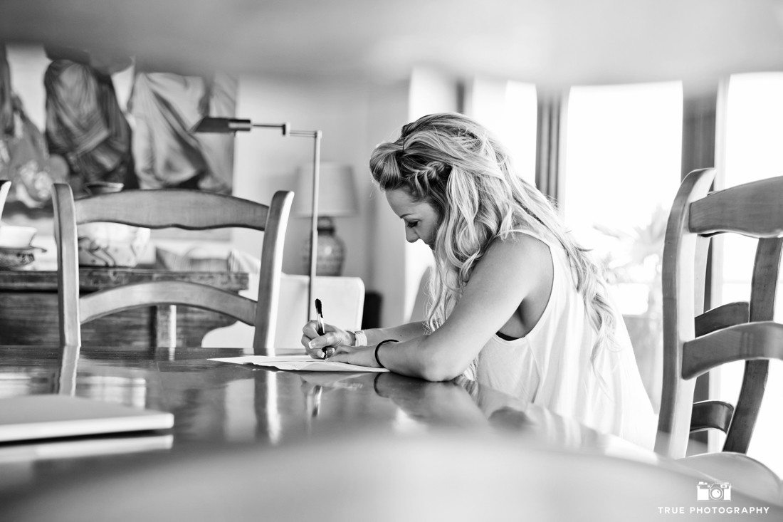 Bride writing her vows in this intimate special candid moment