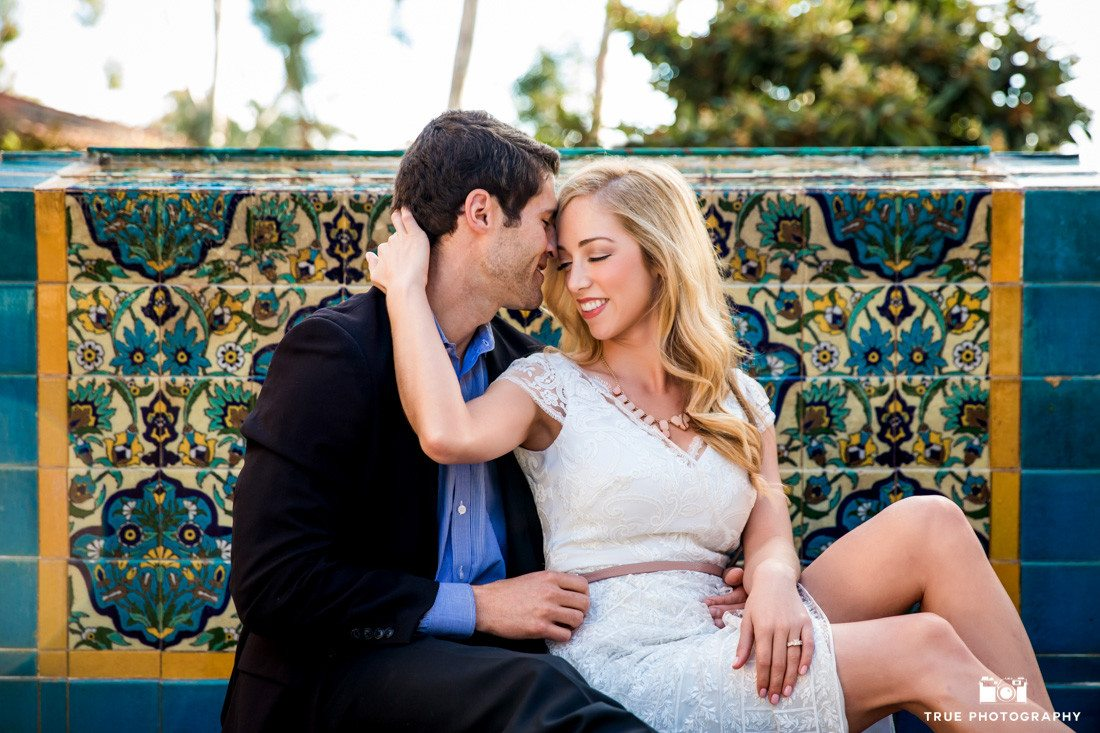 Engagement photo of an intimate young couple at Balboa Park