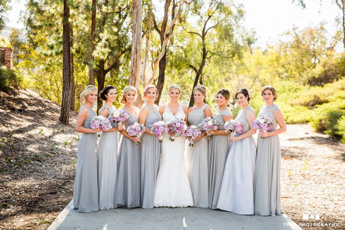 Bridesmaids holding flowers. Photo has Shallow depth of field.