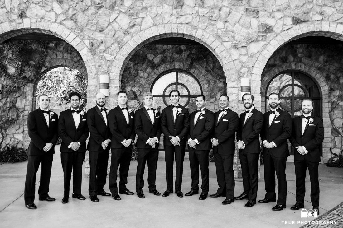 Groomsmen portrait with classic fitted black tuxedos