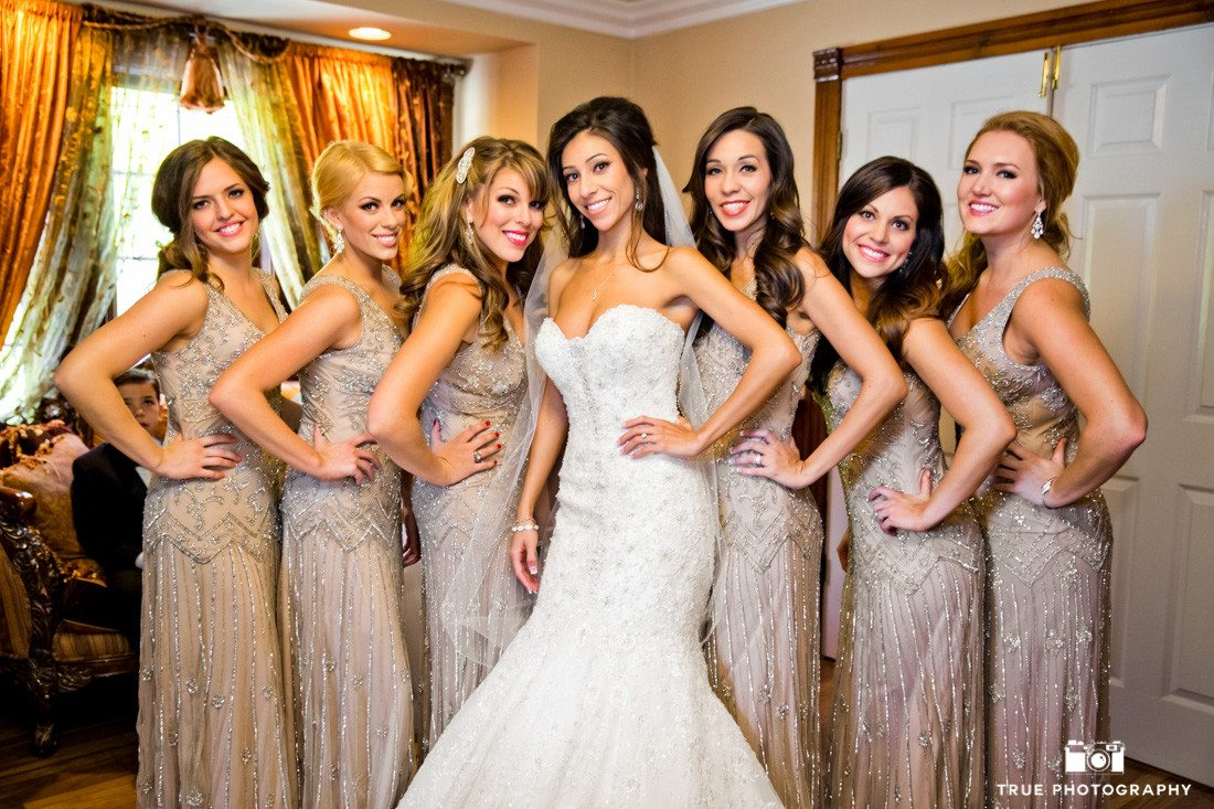 Bridesmaids pose for photo before ceremony