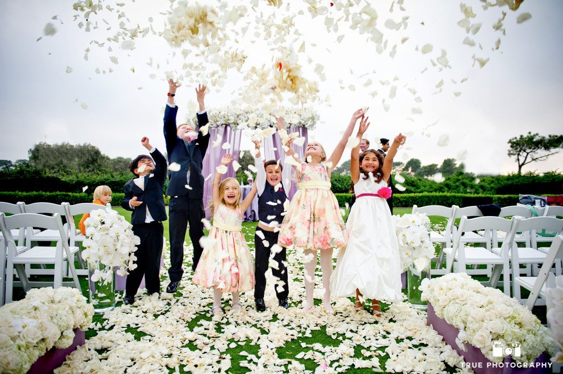 Kids celebrate Bride and Groom's wedding day by tossing flowers