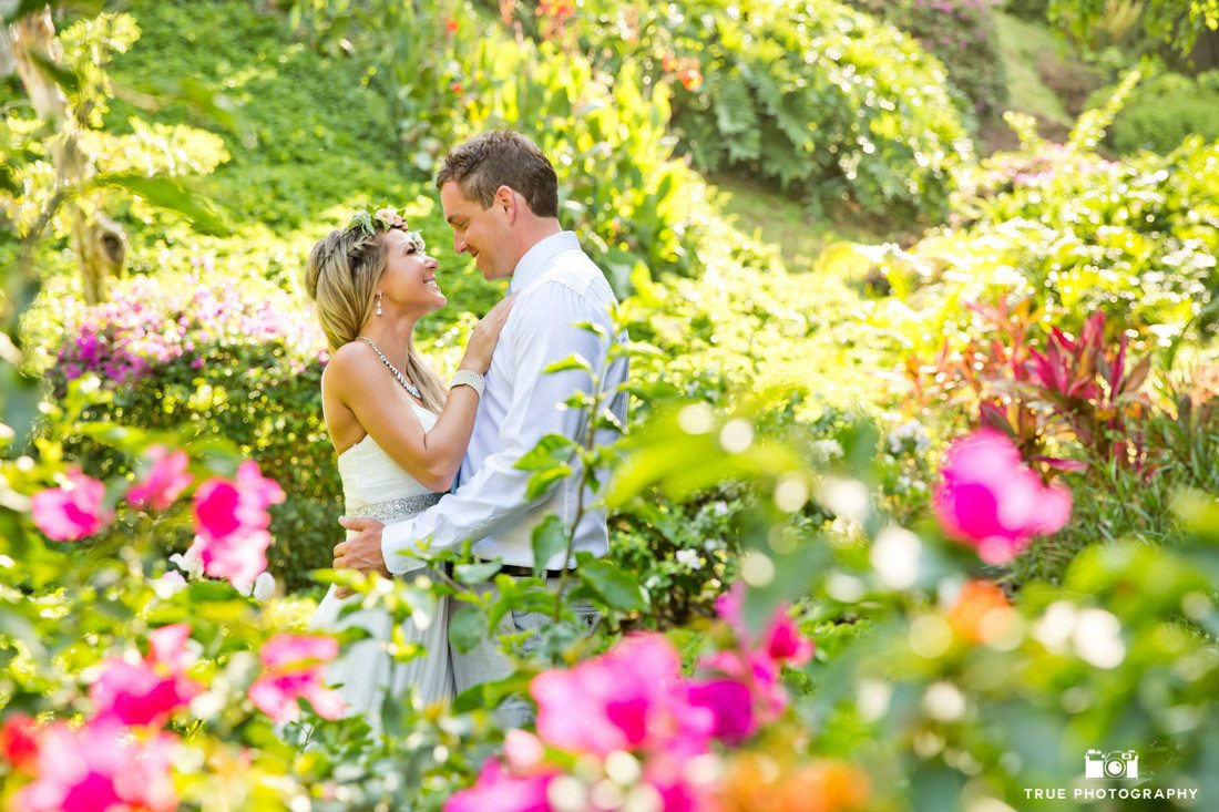 Shooting through flowers to for this romantic destination wedding moment.