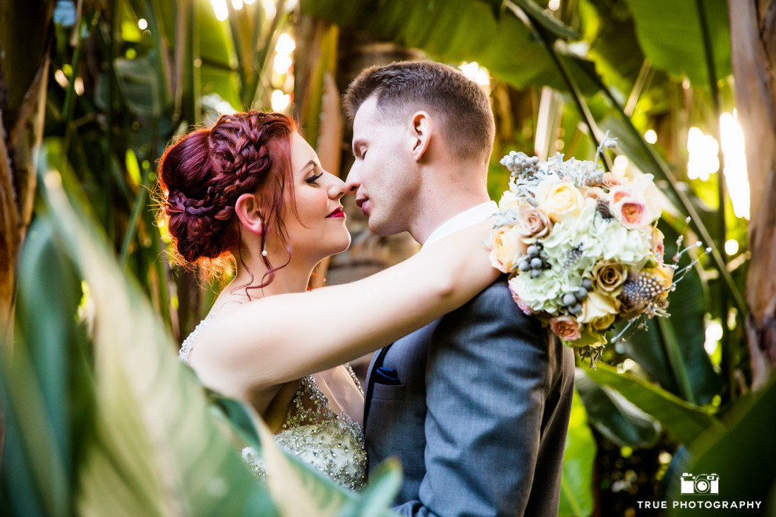 Couple kiss in tropical garden