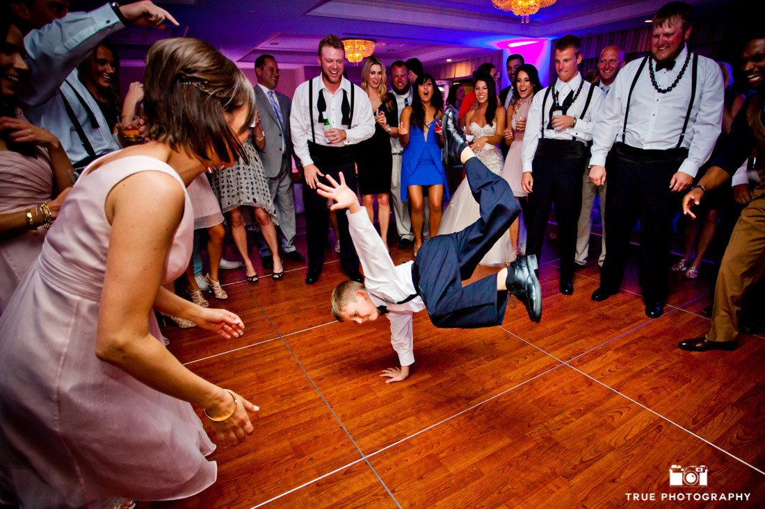 Kid dancing during wedding reception