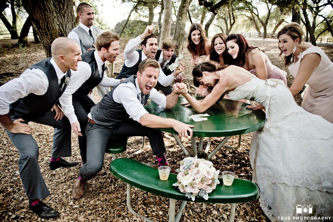Bridal Party has fun arm wrestling for creative photo