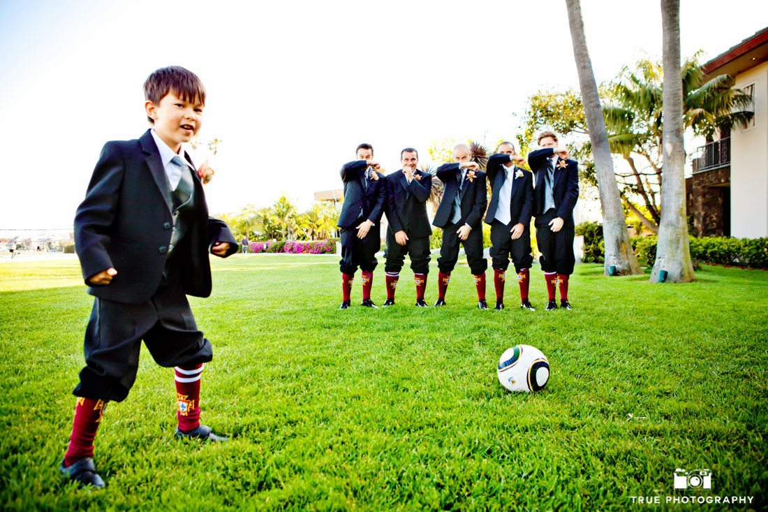 Fun groomsmen soccer photo with ringbearer