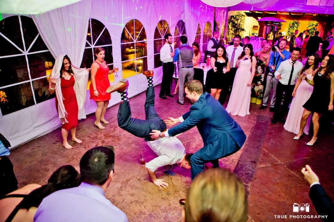 Guests breakdancing during wedding reception
