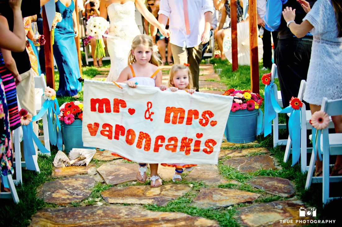 Flowergirls carrying wedding sign