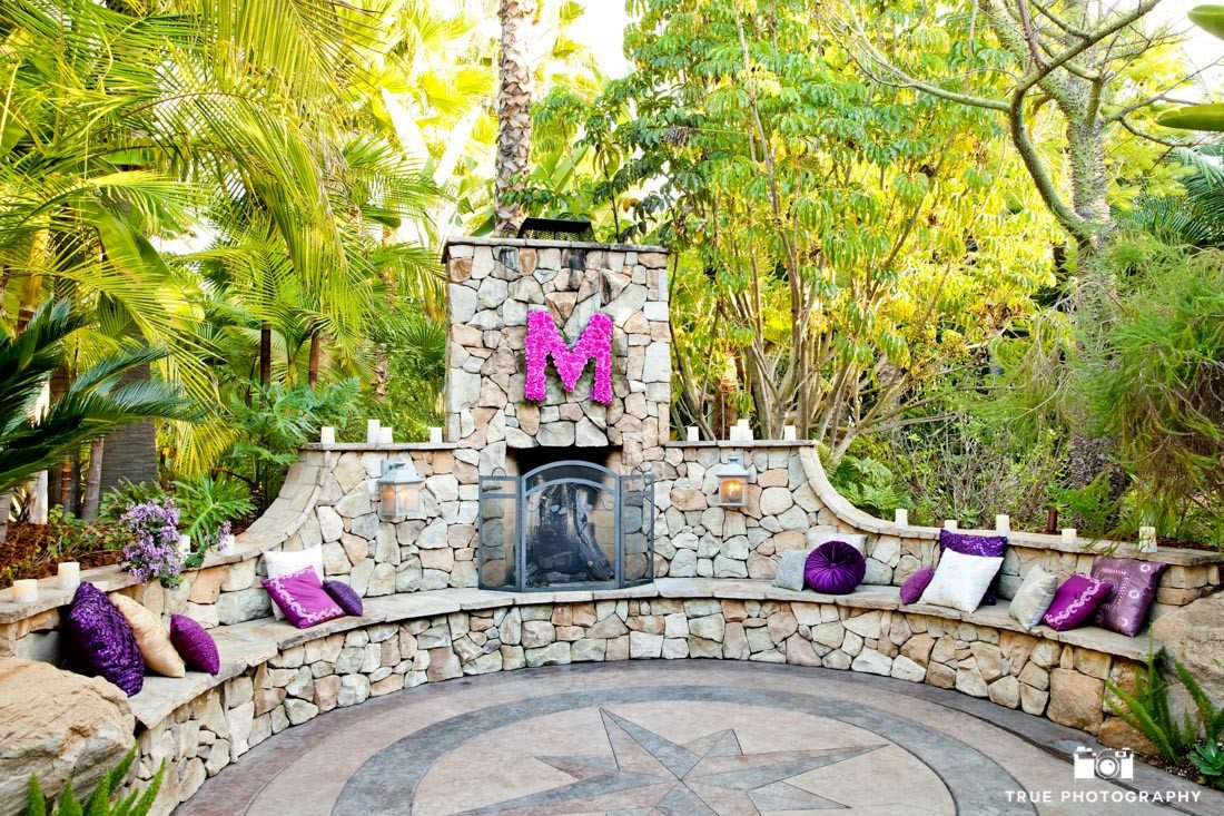 Outdoor fireplace decorated with purple and pink props