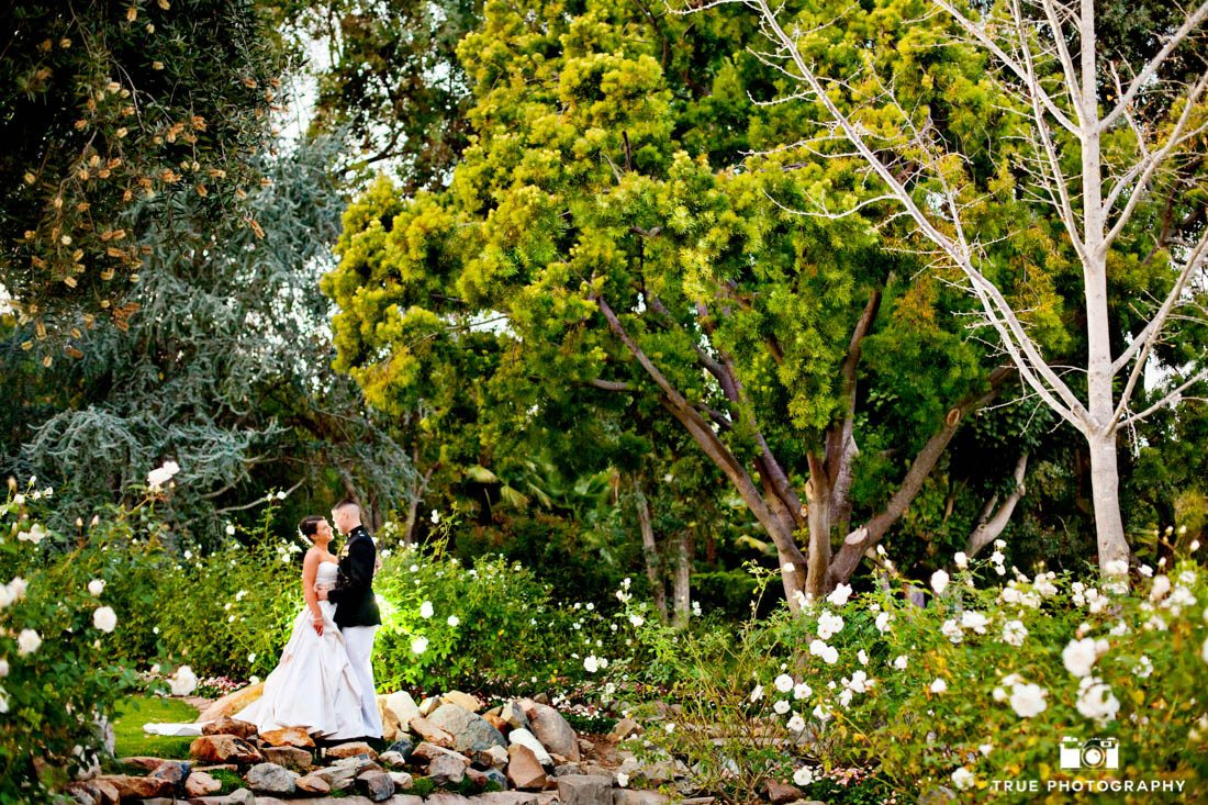 Bride and Groom kiss in fairytale setting