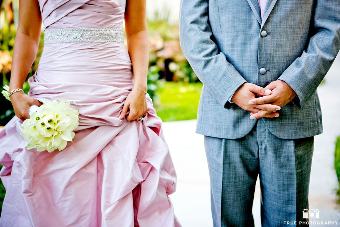 Creative photo with Bride's pink dress and Groom's grey suit