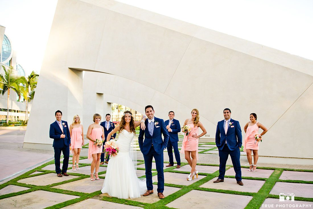 Colorful bridal party wearing blue and pink at Hilton Bayfront Hotel in San Diego, California