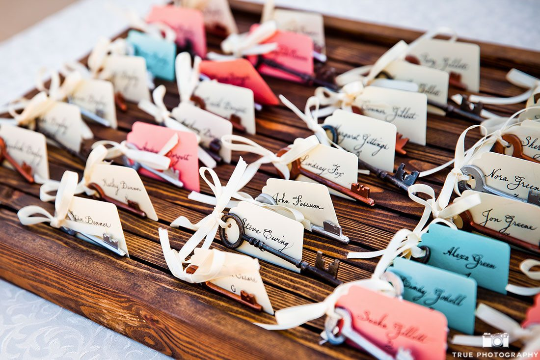 Rustic-inspired blue and pink table holders using keys