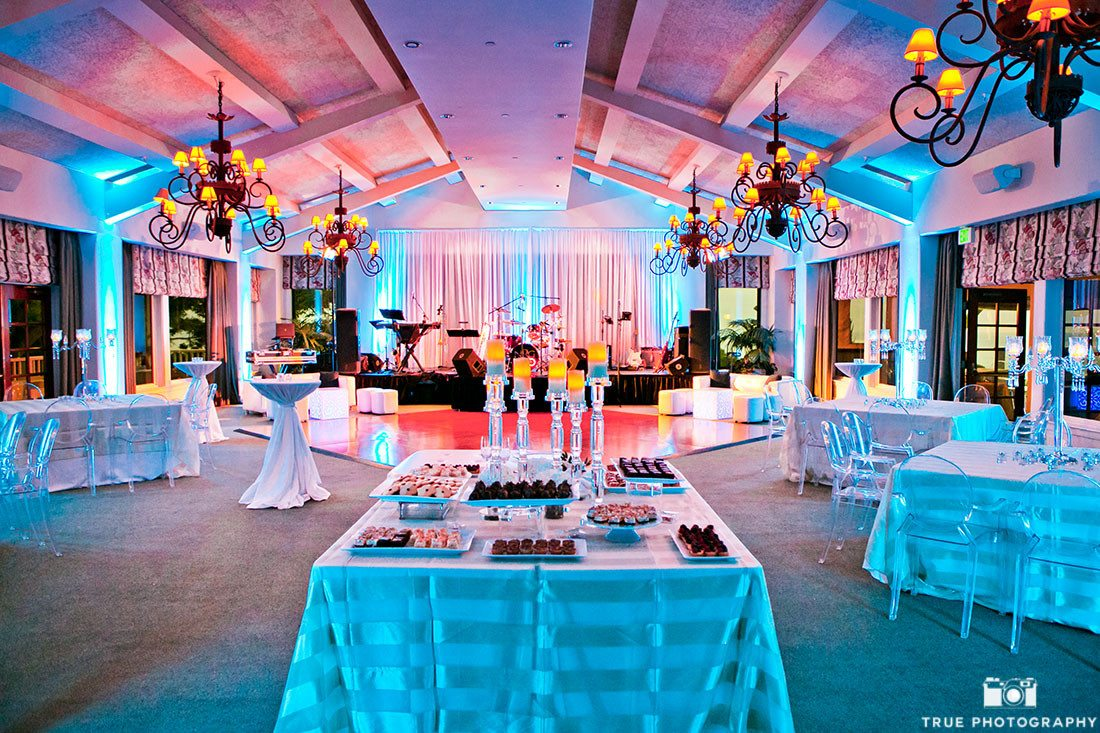 Colorful wedding reception with modern blue and pink lighting