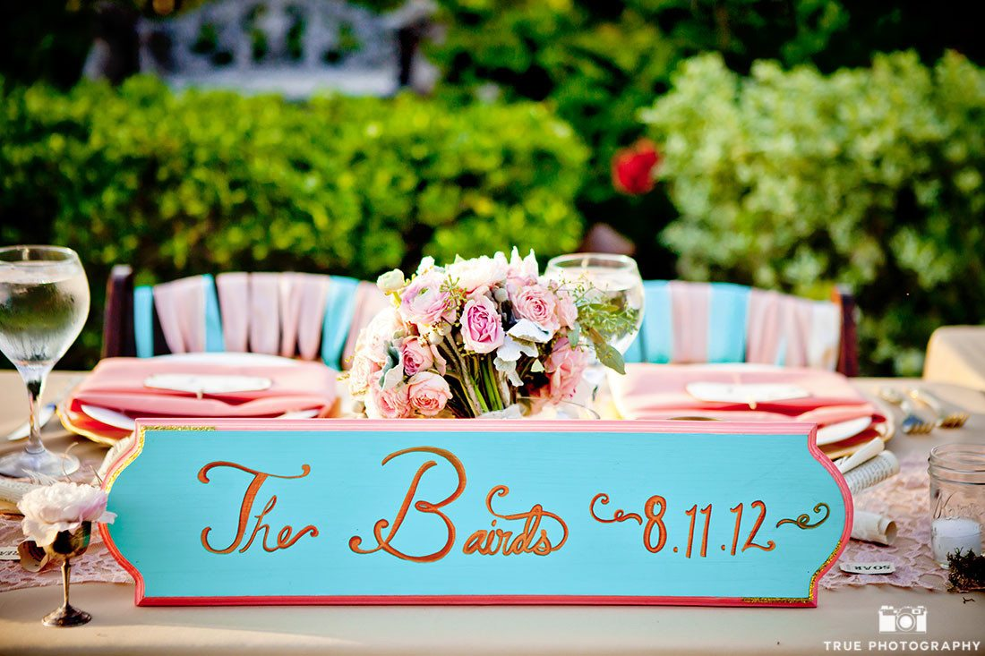 Creative blue and pink wedding sign with couple's name and wedding date