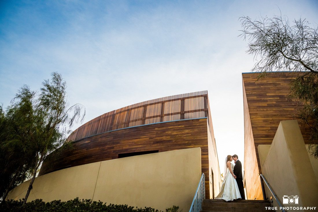 Portrait of bride and groom at Scripps Seaside Forum.