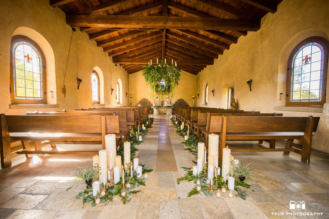 Rustic wedding chapel candles and eucalyptus