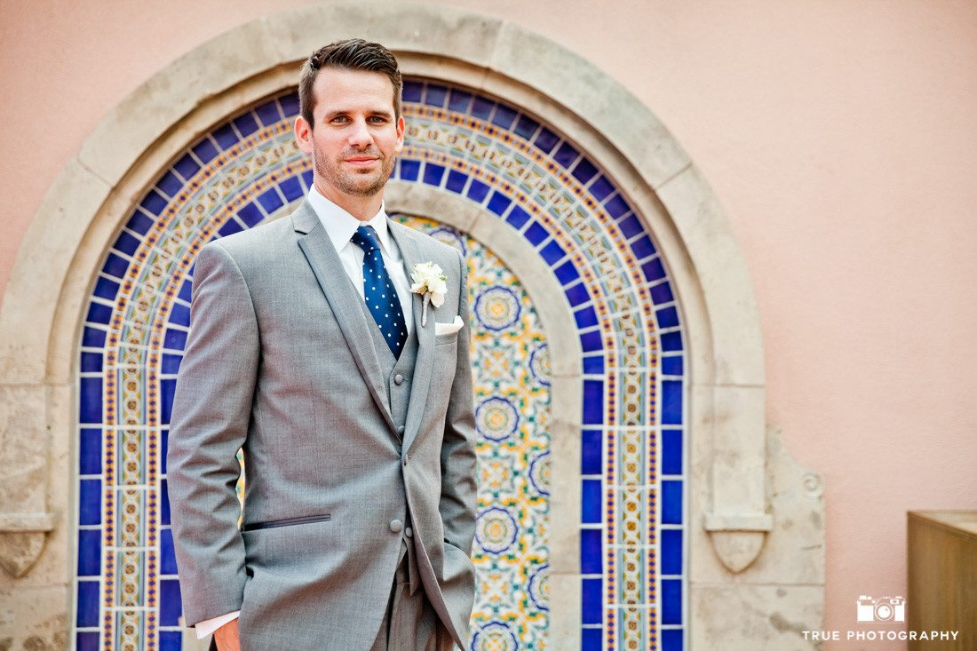 Groom standing in front of textile wall at La Valencia