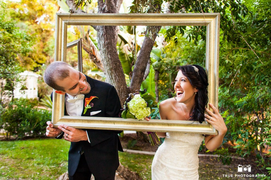 Couple make funny faces while holding vintage frames