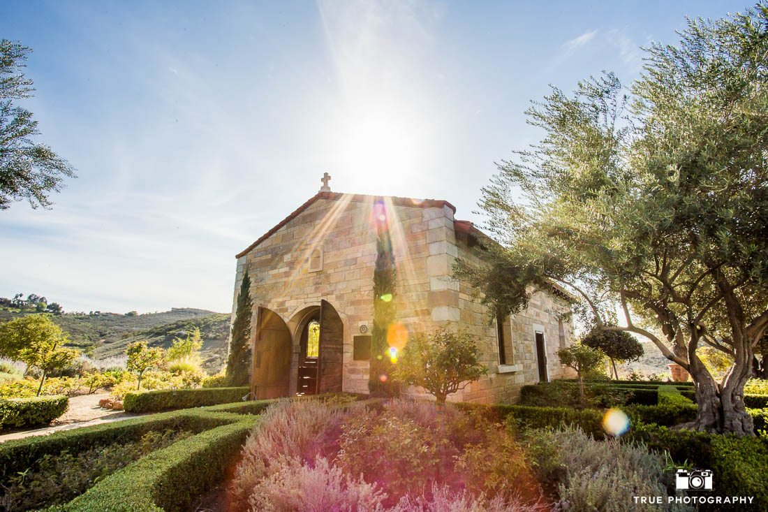 beautiful sun flare photo of rustic chapel at Cal-a-Vie Health Spa wedding