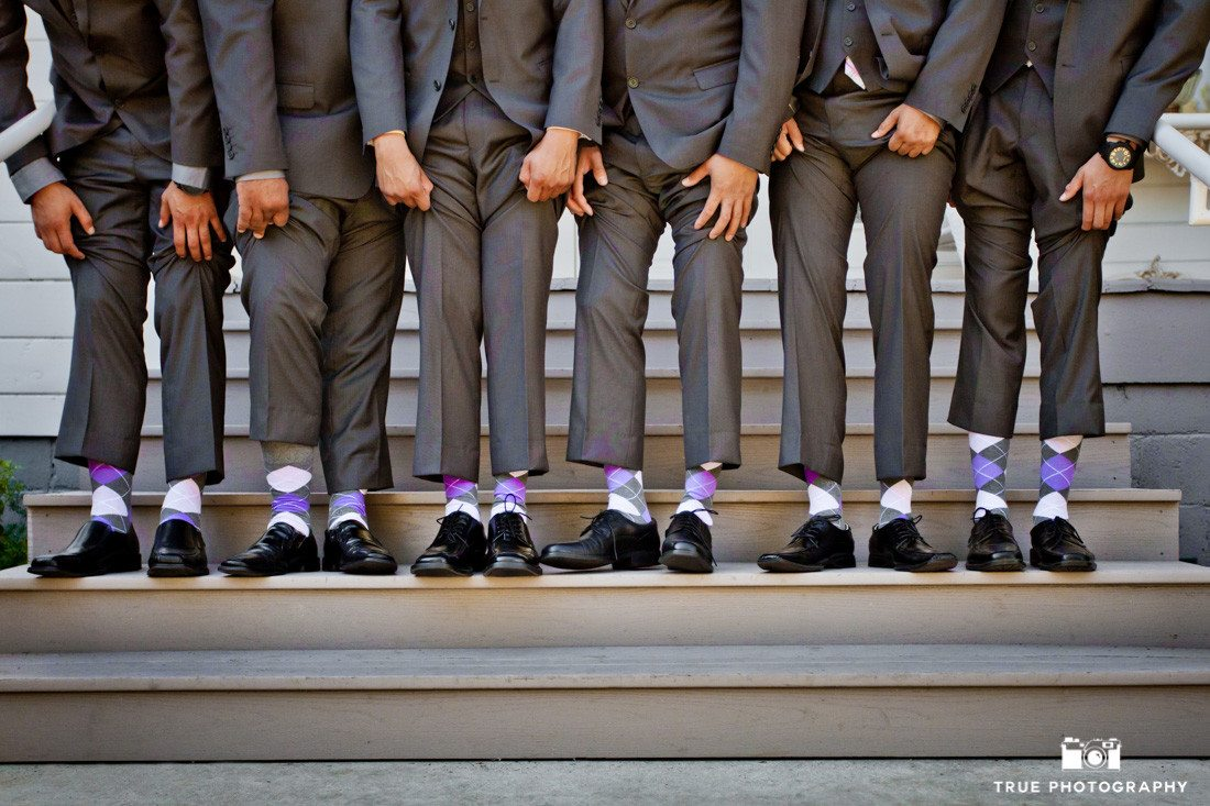 Groomsmen show off fun purple socks