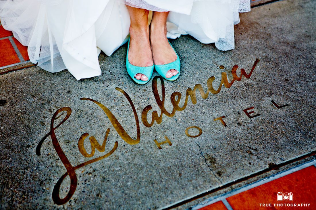 Bride poses with blue wedding shoes at La Valencia